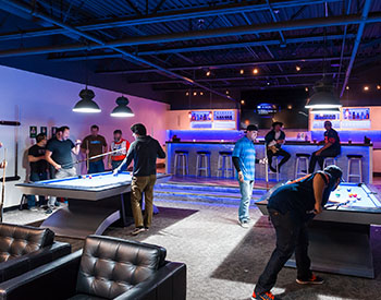Barracuda employees playing pool
